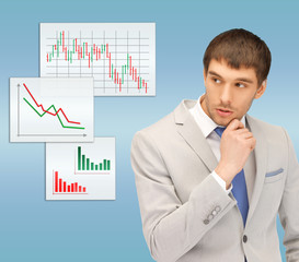pensive man looking at forex charts