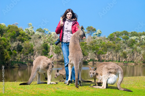 In de dag Kangoeroe Beautiful young woman feeding kangaroos in Phillip Island Wildli