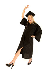 Attractive female model celebrating her college graduation leg o