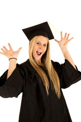 female school graduate in cap and gown celebrating