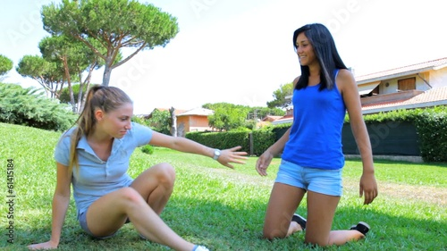 Two young women fighting hard