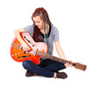 Young beauty music girl with guitar on white background.