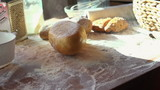 Fresh bread falling on table, super slow motion, shot at 240fps