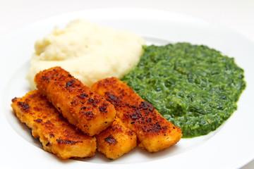 Fischstäbchen mit Kartoffelpüree und Spinat