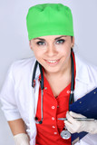 A sexy woman doctor in medical white and red uniform and a green