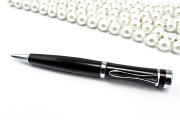 Pen with pearls in a background