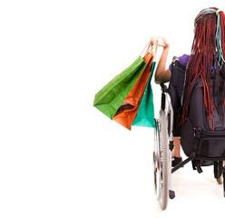 Shopping woman on wheelchair, white background