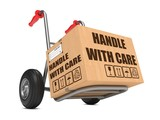 Handle with Care - Cardboard Box on Hand Truck.