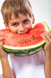 Boy is eating a watermelon