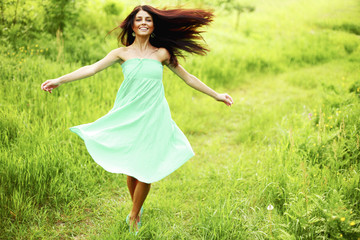 Woman running on meadow
