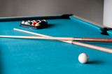 two cue and balls on the table for billiard