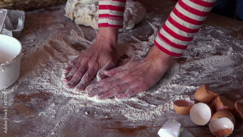 Female hands smoothing dough on table, super slow motion,