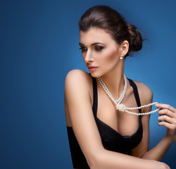 model posing in exclusive jewelry. Professional makeup