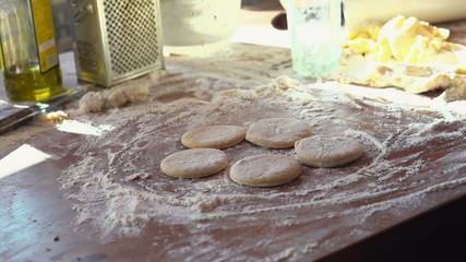 Sprinkling flour on dough, super slow motion, shot at 240fps
