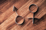 Male and female gender symbols, mars and venus.