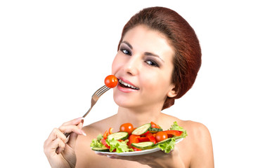 Young Beautiful Girl eating Fresh Vegetables Salad.Vegetarian