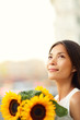 Flower woman holding sunflower smiling happy