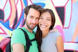 Happy couple selfie portrait, Berlin Wall, Germany poster