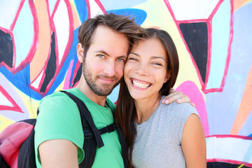 Happy couple selfie portrait, Berlin Wall, Germany