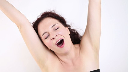 Woman waking up, stretching and yawning (real)