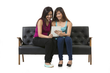 Tow Chinese female friends using a Digital Tablet PC.