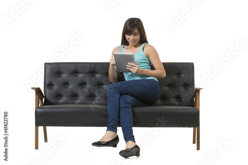 Young Asian woman sitting using a Digital Tablet PC.