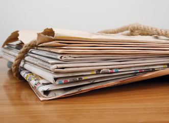A newspaper stack isolated on wood background
