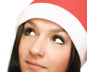 A young woman in a Christmas hat, isolated on white background