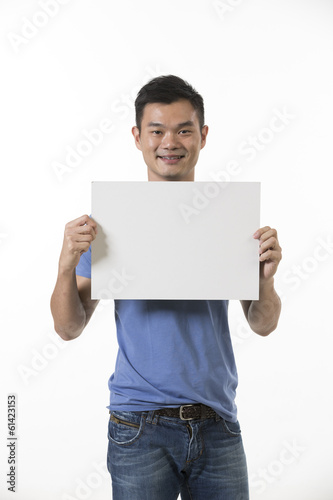 Chinese man holding up a banner.