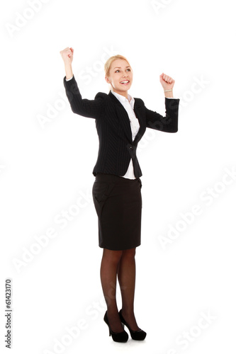 A young woman showing a fist, isolated on white background