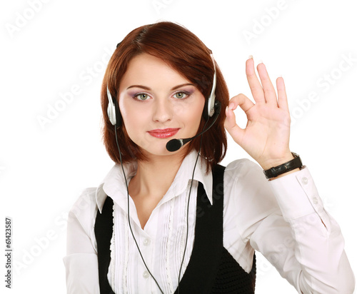 Woman with headset showing OK , isolated on white background