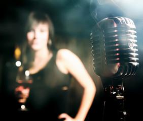 Retro microphone and a female silhouette.
