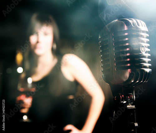 Retro microphone and a female silhouette.