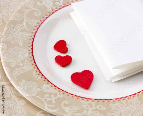 Red heart in plate.