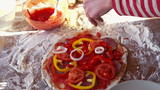 Onion slices falling on tasty pizza, super slow motion,