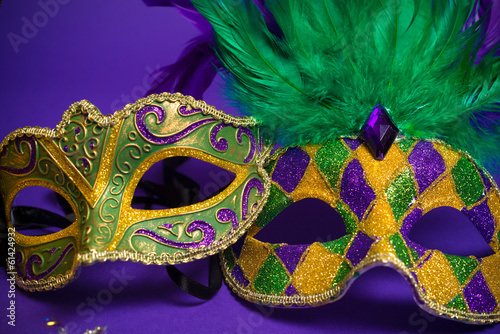 Assorted Mardi Gras or Carnivale masks on a purple background