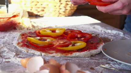 Tomato slices falling on tasty pizza, super slow motion, 240fps