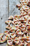 Colored pasta on wooden background