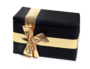 Gift with golden ribbon