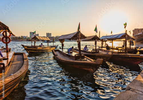 Boats on the Bay Creek in Dubai, UAE - 61425751