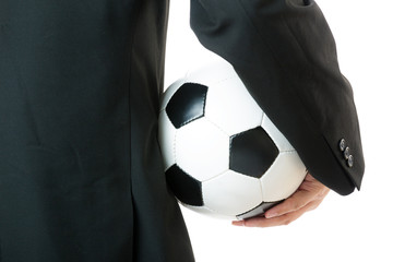 Back view of Businessman holding soccer ball