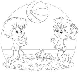 Children play a ball on a beach