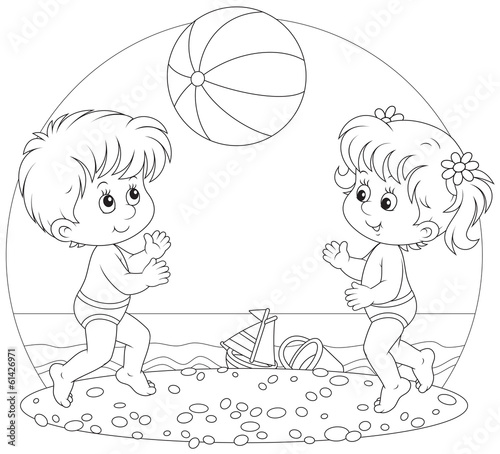Children play a ball on a beach