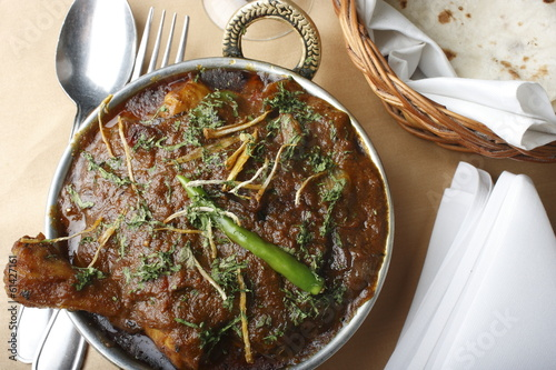 Boneless diced chicken cooked in a traditional Kadhai (wok)