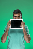 Indian man using a tablet PC