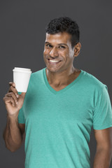 Happy Indian man with a takeaway coffee cup