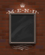 Menu chalkboard in wooden frame on vintage brick wall