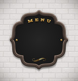 Menu chalkboard in wooden frame on white brick wall