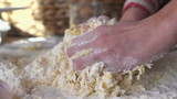Woman kneading dough on the table, super slow motion, 240fps