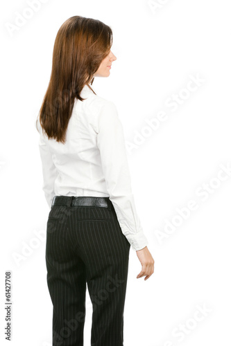 Business woman looking at something, from the back, isolated